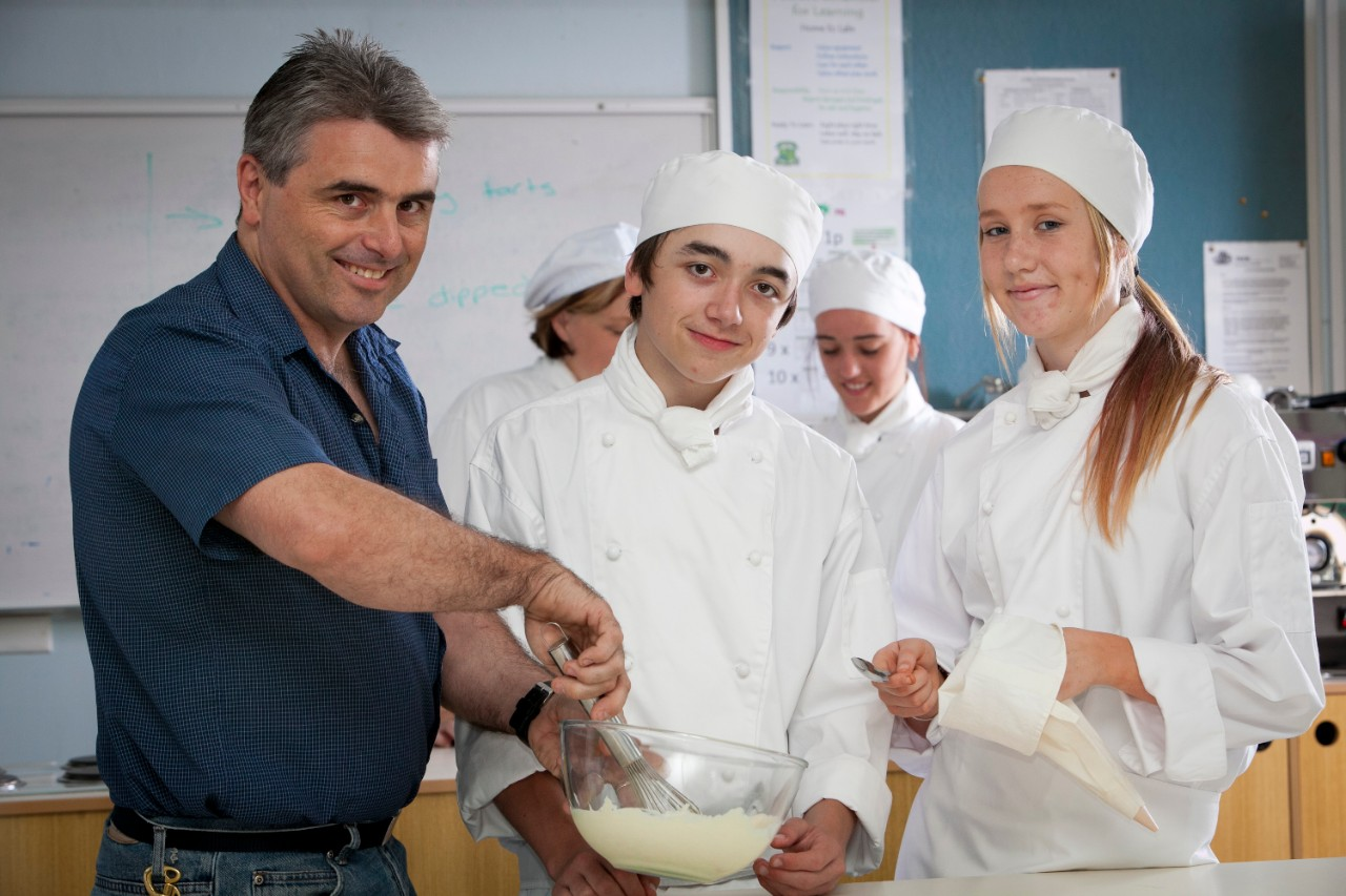 Students baking in food tech
