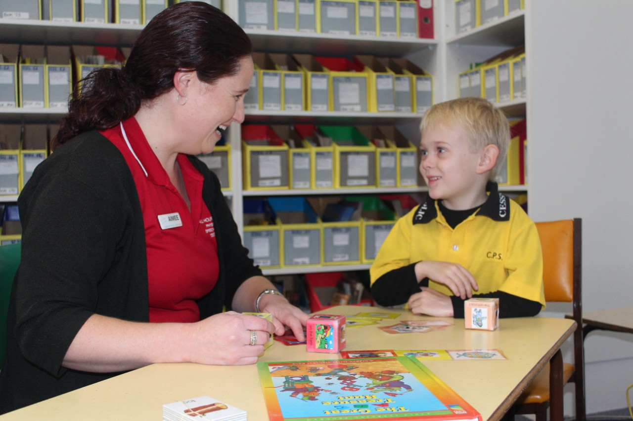 A student working with a speech pathologist